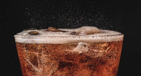 close-up-ice-cola-in-glass-and-bubble-soda-splashing-on-black-picture-id858867994 (1) carbonation